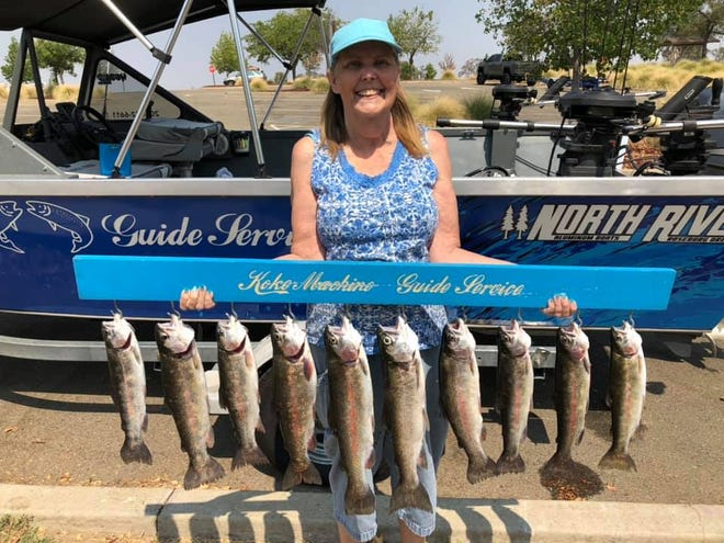 Dianne Stockton shows off the 10 rainbow trout that she and Robbie Dunham of Koke Machine Guide Service landed at Camanche Reservoir on Sept. 4.