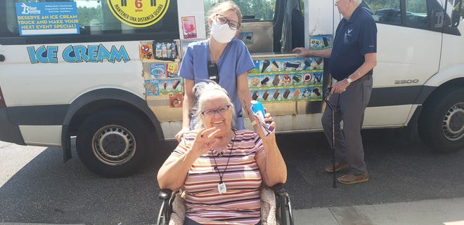 An ice cream truck visited the residents of Vista Veranda, an assisted living facility in Ravenna. Staff arranged for the visit  to take place in late August. Pictured, resident Sally Viall and caregiver Francis Hughes pose for a picture, all smiles and ice cream in hand.