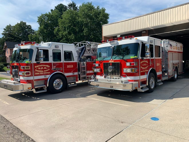 Two fire trucks sit in front of the fire district for the Garrettsville-Freedom-Nelson Fire District. The fire district is among those looking for other options now that Aurora is ending outside dispatch contracts.