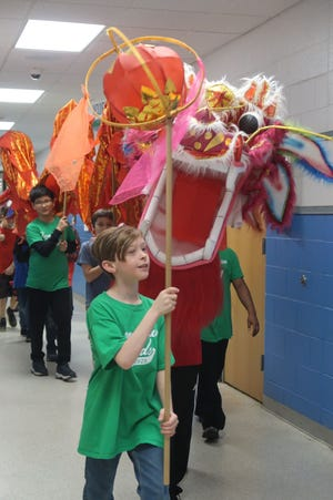 Students at Farmington Woods IB in Wake County participate in a Chinese cultural activity.