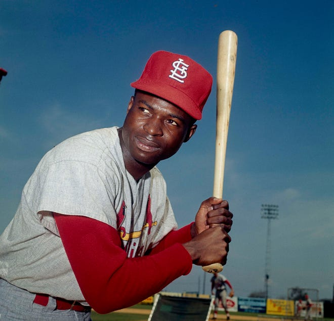 In this April 9, 1965, file photo, Lou Brock of the St. Louis Cardinals poses in Missouri. Hall of Famer Brock, one of baseball's signature leadoff hitters and base stealers who helped the Cardinals win three pennants and two World Series titles in the 1960s, has died. He was 81.