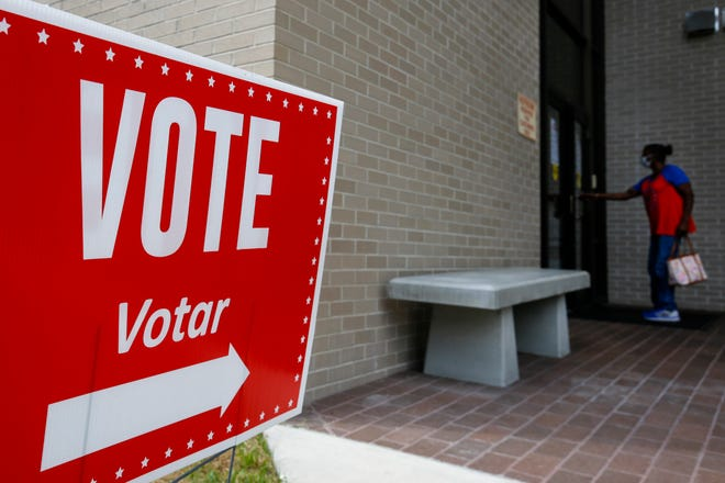 A person walks inside to vote early at the Alachua County Supervisor of Elections Office in Gainesville on Aug. 8.