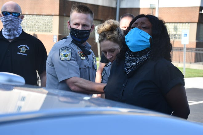 Alamance County Sheriff's deputies arrest Dionne Liles at Tuesday's demonstration at the county jail. Liles was one of four people arrested. (Photo by Dean-Paul Stephens/Times-News)