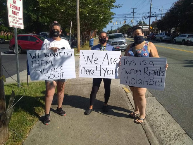 (From left) Amy Cooper, Tabatha Davis and Theresa Draughn protest outside the Alamance County Sheriff's Office Tuesday, Sept. 8. Four people were arrested during the demonstration.