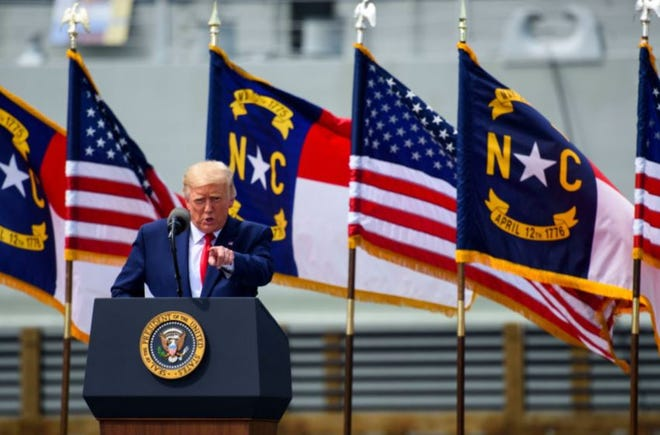 President Donald Trump speaks to a small crowd outside the USS North Carolina on Sept. 2, 2020 in Wilmington, North Carolina.