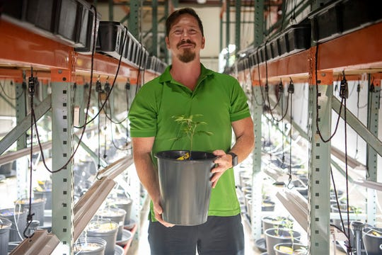 """Craig Cunningham, founder of Munchy Farms, stands for a portrait in the veg room on Wednesday, Sept. 2, 2020 in Springfield, Mich. """"It's a dream come true. To think four months ago I was still sitting in a cubicle, coming here every night and weekends, now to be here every day doing this, it doesn't feel like work."""""""