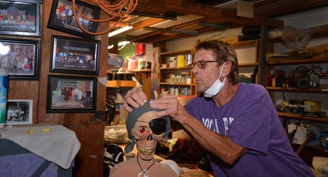 Mark Papson at work in the prop room. Surfside Playhouse is very fortunate to have Mark Papson as their propmaster. Papson has years of experience in Hollywood, working with studios such as Warner Brothers and Disney, among others.