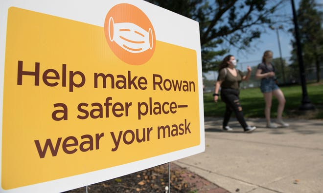 A sign on the campus of Rowan University in Glassboro reminds students to wear a mask to help make Rowan a safer place.