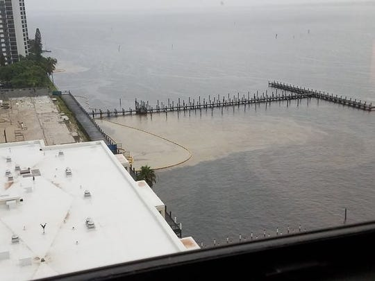 Runoff from construction in downtown Fort Myers Monday flows in to the Caloosahctehee River past barriers designed to contain it for the third time in recent months.