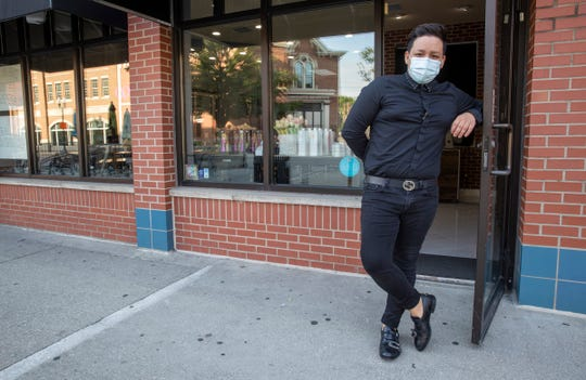 Frank Rodriguez, at Frank Hair Artist, a full-service hair salon on Massachusetts Avenue, Indianapolis, Tuesday, Sept. 8, 2020. Rodriguez said his family moved to Indiana fourteen years ago, following the murder of his brother to gangsters in El Salvador.