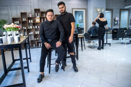 Frank Rodriguez (left), with boyfriend and stylist Luis Perez, at Frank Hair Artist, a full-service hair salon on Massachusetts Avenue, Indianapolis, Tuesday, Sept. 8, 2020. Rodriguez said his family moved to Indiana fourteen years ago, following the murder of his brother to gangsters in El Salvador.