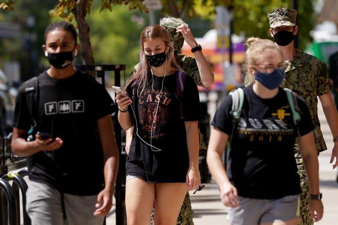 Pedestrians walk along State Street, Tuesday, Sept. 8, 2020 in West Lafayette.