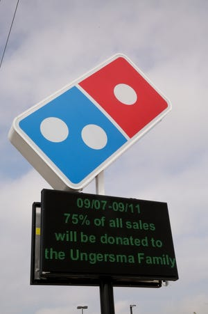 """""""09/07-09/11 75% of all sales will be donated to the Ungersma Family"""" scrolls across an electronic display outside of Domino's, 2504 Greenbush St., Tuesday, Sept. 8, 2020 in Lafayette. Josh Ungersma, a delivery driver at the Domino's, was shot and killed last week while delivering a pizza on 16th Street near Hart Street."""