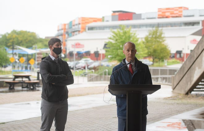 Lansing Mayor Andy Schor announces the newly proposed riverfront redevelopment at the former Lansing City Market, Tuesday, Sept. 8, 2020, in downtown Lansing.  The building may be leased to Detroit Rising Development and transformed into the Lansing Shuffleboard & Social Club.  Plans include food, drink, games, community classes, and entertainment.  Also pictured is developer Jon Hartzel, left, of Detroit Rising Development.