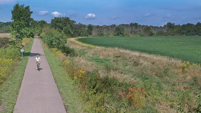 A cyclist approaches Kocheiser Road between Lexington and Bellville on Tuesday afternoon during a bike ride on the Richland B&O Trail.