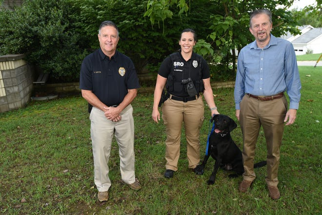New MHPD canine Rocky is seen here with his handler officer Danielle Campfield, center, Assistant Police Chief Eddie Griffin, left, and Prosecuting Attorney David Ethredge.