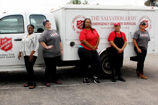 April Calvin, left, Tiffany Ladd, Ulonga Lott, Adel Gisele and Angela Simms are part of the Salvation Army team that provides more than 400 meals every day at four locations in Nashville. The daily meals have been going out since the tornado in March.