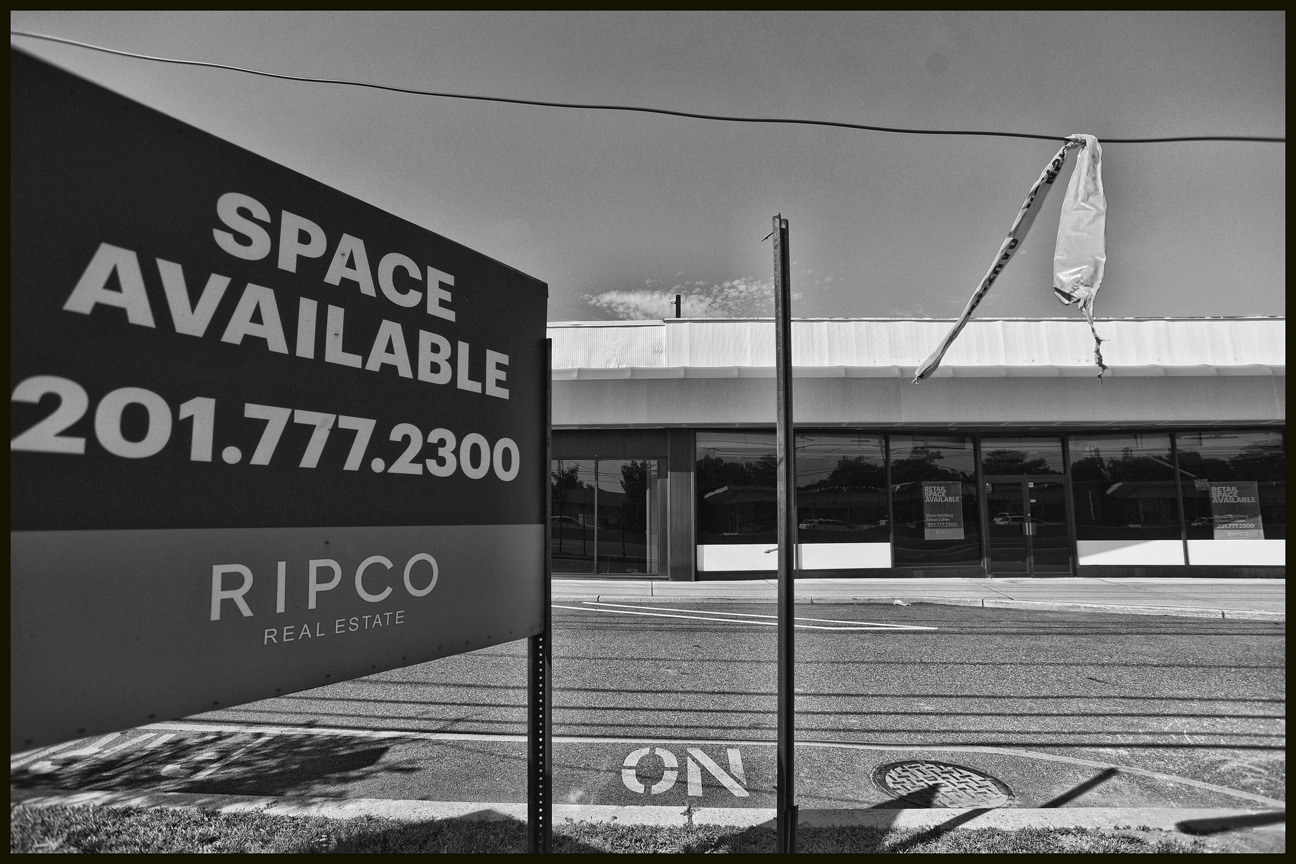 A space available sign stands in front of an empty store along Rt. 4 East in Paramus.