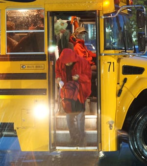 A student exits the bus at Novi High's Taft Road entrance the first day back to school last September.