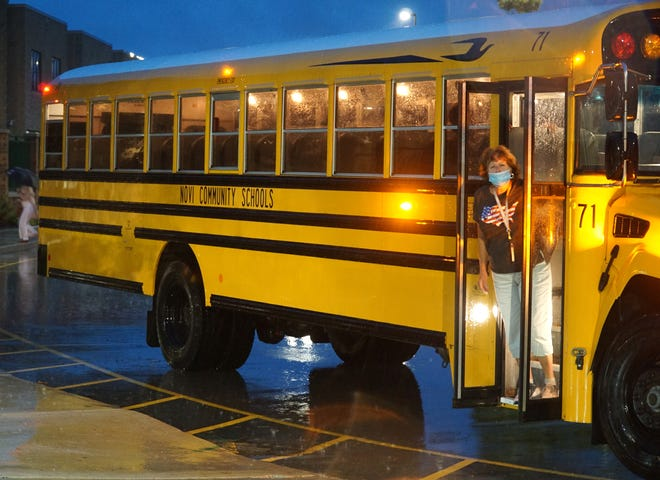A Novi Community Schools bus pulls up to Novi High's Taft Road entrance around 7 am on Sept. 8, 2020 - the first day back at in-class sessions since last March.
