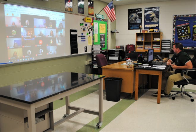 John Farkas taught all classes virtually from his classroom at Holmes Middle School on the first day of fall classes.