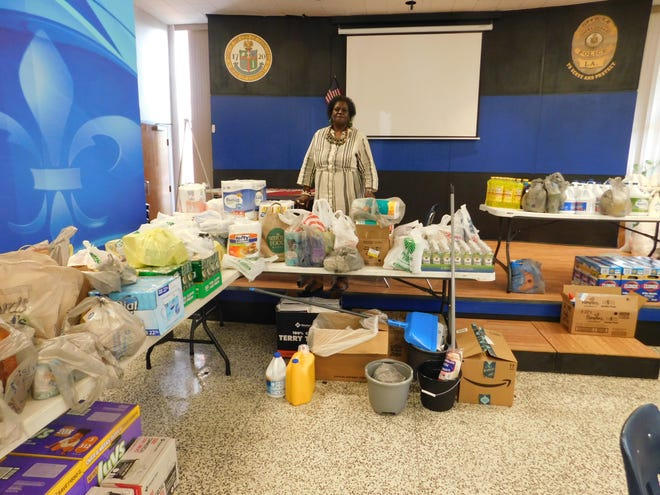 Carolyn Thomas, records clerk for the Opelousas Police Department, organizes donated items for the department's relief effort for Hurricane Laura.