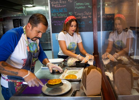 Ruben and Maria Lopez prepare a dish at Pachamama in Phoenix Sept. 6, 2020. The new vegan restaurant plans a grand opening Sept. 16.