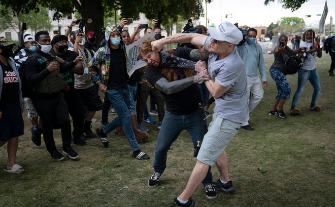 A scuffle between protesters and supporters of President Donald Trump at Civic Center Park in downtown Kenosha, Wisconsin, after Trump's visit nine days after the police shooting of Jacob Blake unleashed unrest in the city, Tuesday, Sept. 1, 2020. (E. Jason Wambsgans/Chicago Tribune/TNS)