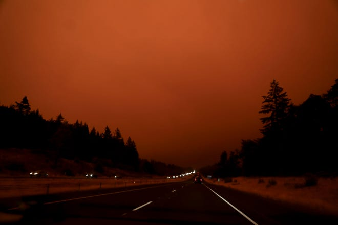 Smoke from multiple wildfires grows thicker on Highway 22 eastbound near Aumsville, Oregon, on Sept. 8, 2020. Safety crews have Highway 22 east bound blocked starting at exit 13.