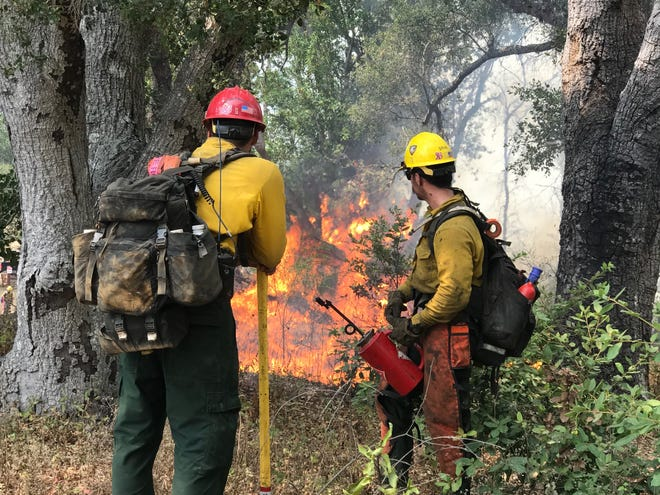 Firefighters work the Dolan Fire in Big Sur. Sept. 8, 2020.