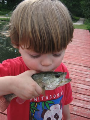 Fish kissing is a prominent past time for Louisiana youngsters through the LDWF.