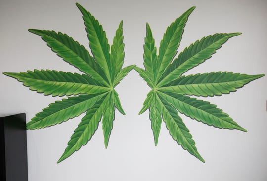 The Old Route 66 Wellness medical marijuana dispensary has marijuana leaves painted on the wall for customers to take selfies.