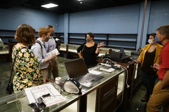 """Missouri medical marijuana businesses like Cassville Dispensary are going through """"commencement"""" inspections with state health authorities and say they'll open soon. During an inspection visit on Thursday, Sept. 3, 2020, dispensary owner Dr. Lisa Roark, center, explains how patients will check out after selecting cannabis products."""