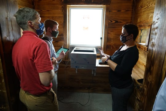 Cassville Dispensary owner Dr. Lisa Roark (right) discusses a secure drive-through window with two Missouri health department inspectors on Sept. 3, 2020. The dispensary expects to open soon.