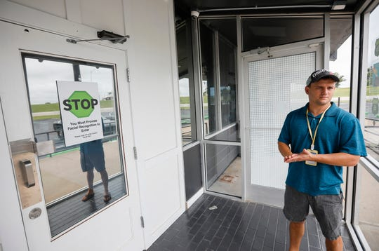 John Lopez, owner of Old Route 66 Wellness, explains the security measures at the front entrance of the medical marijuana dispensary.
