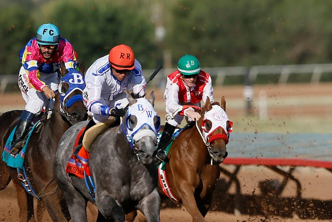 Ricky Ramirez takes first place in the All America Quarter Horse Futurity riding Whistle Stop Cafe during All American Weekend Monday, Sept. 7, at the Ruidoso Downs Race Track and casino in Ruidoso, N.M.