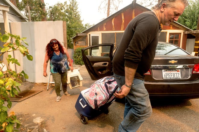 Jim Butler evacuates from the North Fork community in Madera County, Calif., as the Creek Fire approaches on Monday, Sept. 7, 2020. (AP Photo/Noah Berger)