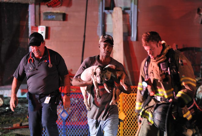 Wichita Falls firefighters worked to control a fireTuesday morning in a small apartment building located on Avenue G. A neighbor rushed to the rescue after some puppies were reportedly pulled from the fire.