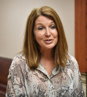 Dixie Carter of Panda BioTech talks about the advantages of opening the Texas Plains Hemp Gin in Wichita County following a Commissioners Court hearing Tuesday afternoon.