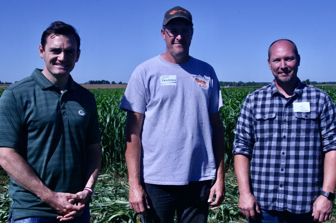 Eighth District Rep. Mike Gallagher, left, and brothers Scott and Todd Brandenburg, helped showcase conservation efforts on Brand Acres beef farm.