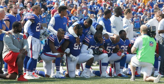 Members of the Buffalo Bills kneel in protest during the national anthem in 2017 after President Donald Trump ripped players for their peaceful protests.