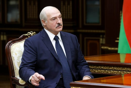 Belarusian President Alexander Lukashenko listens to the head of the Investigative Committee Ivan Naskevich during their meeting in Minsk, Belarus, Monday, Sept. 7, 2020. (Nikolai Petrov, BelTA via AP) ORG XMIT: XAZ110