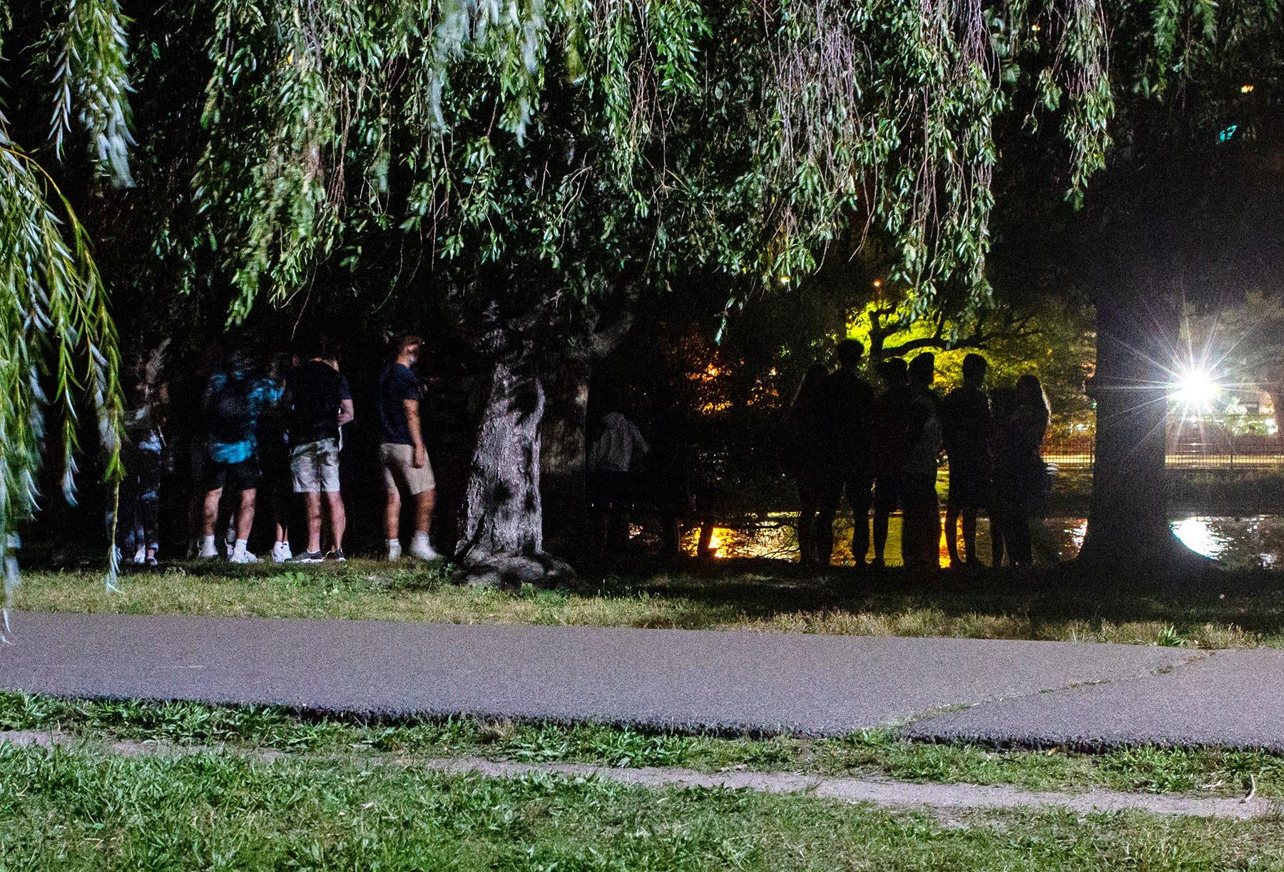 Boston University and Northeastern University students gather on the Charles River Esplanade on Friday.