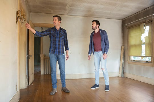 "Jonathan and Drew Scott walk through a home in need of a renovation for Season 7 of ""Brother vs. Brother."""
