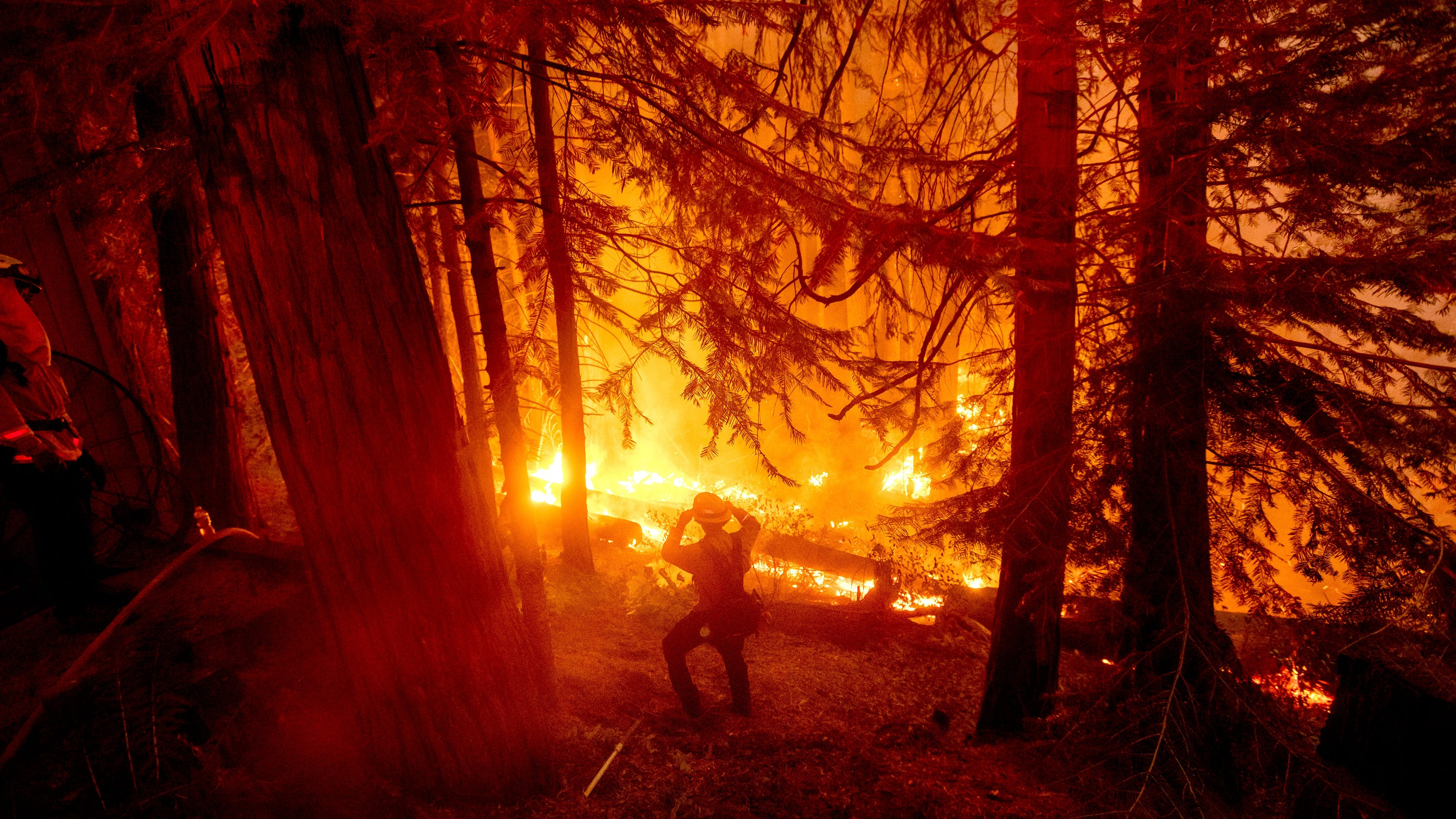Historic wildfires rage across Pacific Northwest: Washington town devastated; helicopters rescuing stranded California hikers – USA TODAY
