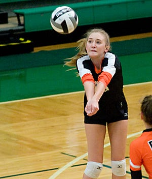 Marlington's Brianna Kurtz sets a shot in an Eastern Buckeye Conference match against the Warriors at the West Branch Fieldhouse Tuesday, September 8, 2020.
