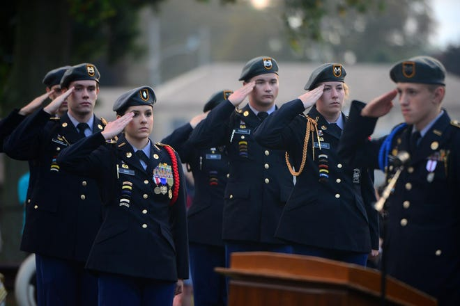 In this Sept. 11, 2019, file photo, Beaver Area JROTC members salute during the 9/11 remembrance ceremony at the high school.