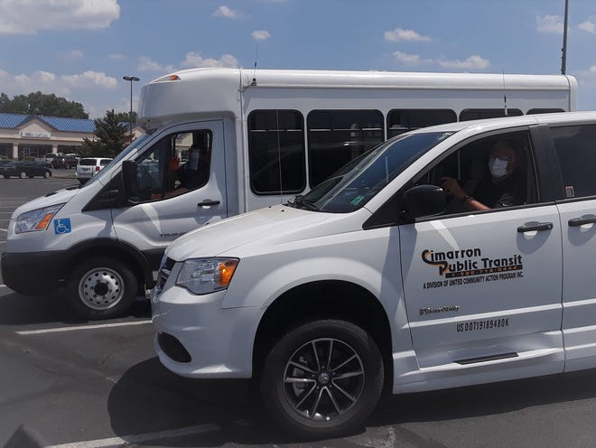 In the new Pick Transportation mobility on demand pilot program, a fleet of minivans and cutaway buses, like those pictured, will be used for on-demand, after-hours public transportation.