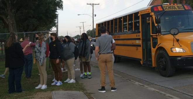 Students file off buses Tuesday morning for the first day of class for the new school year at Terrebonne High in Houma. Students lined up to have their temperatures checked, one of the safety measures in place amid the COVID-19 pandemic.