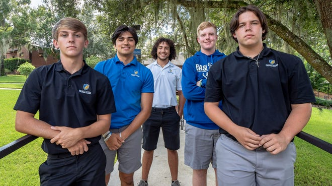 From left, Ashton Gebhardt, Zarick Diaz, Christian Kupchick, Samuel Baker and Zack Wilson and pose at Mount Dora Christian Academy in Mount Dora. [PAUL RYAN / CORRESPONDENT]